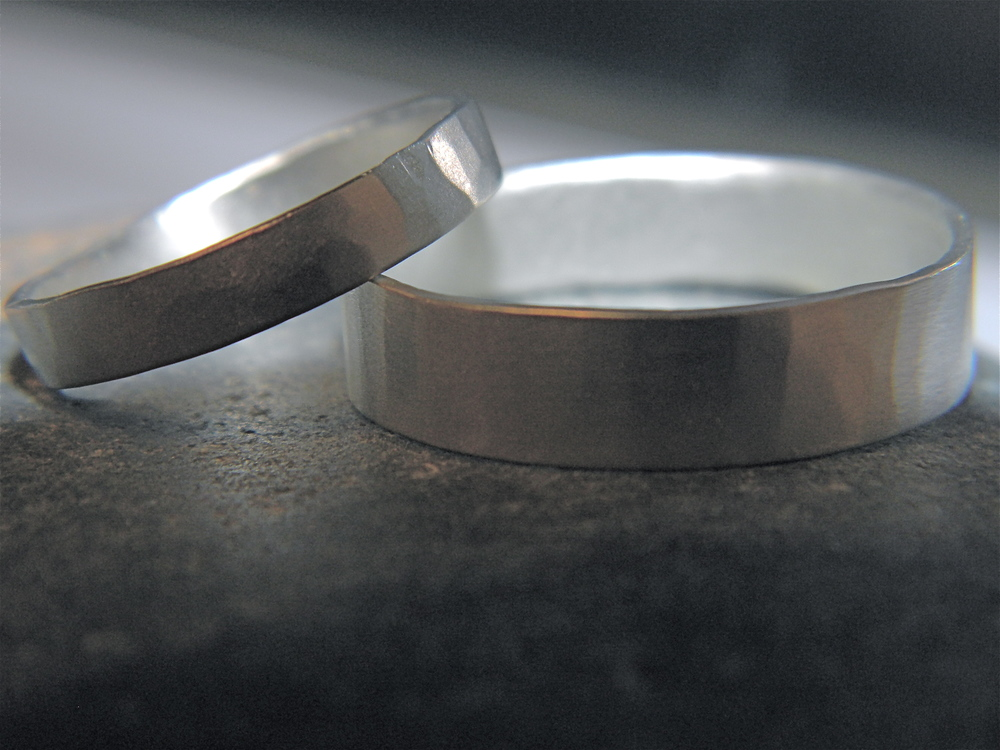 Sterling silver bands with light hammered texture and a matte finish