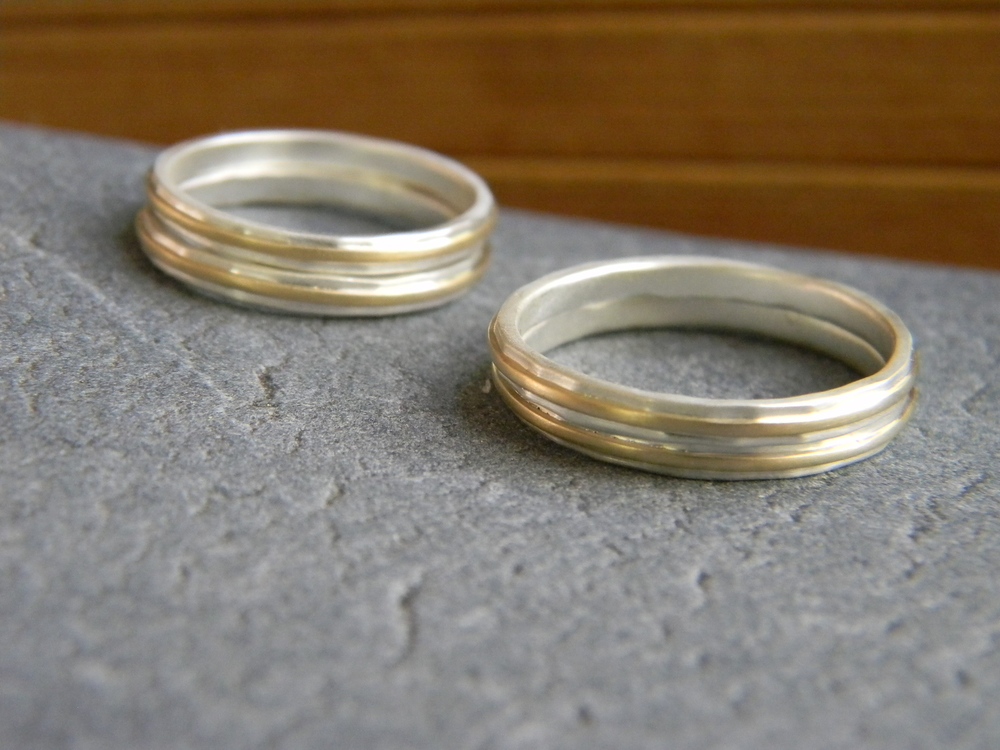 Hammered sterling silver bands with 14k recycled gold