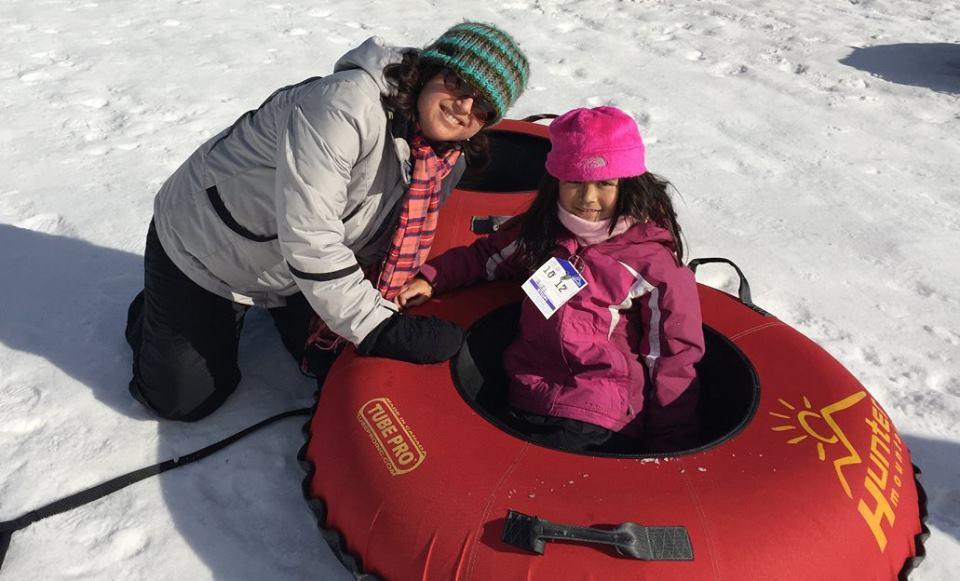 paula and daughter tubing.jpg