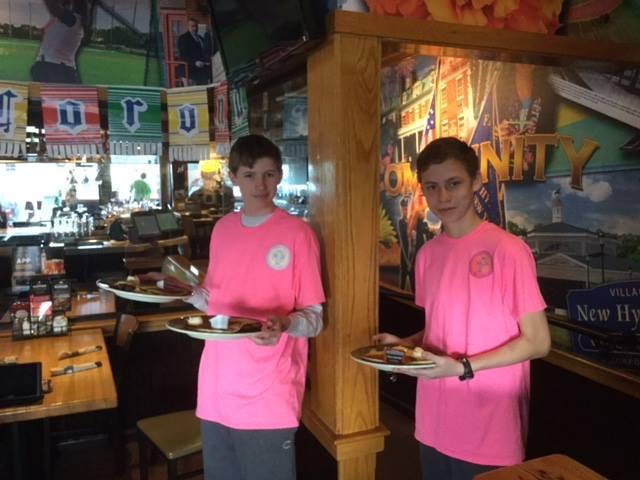 boys serving food.jpg