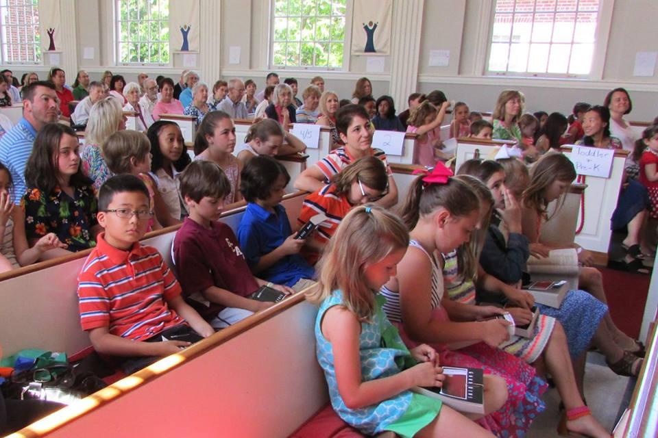 third graders in pew.jpg