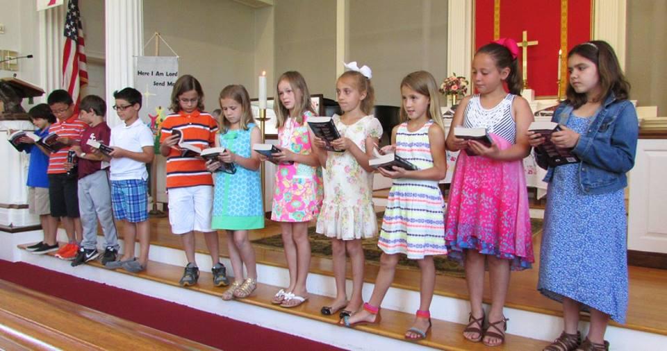 third graders on altar.jpg