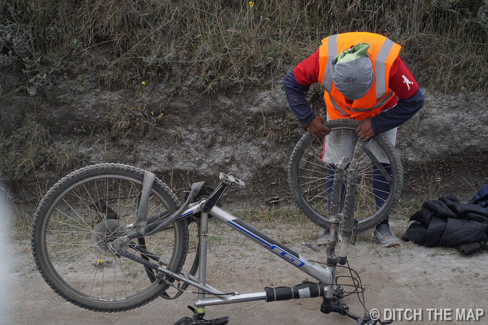 Our Guide tries to fix my bike in Cotopaxi, Ecuador