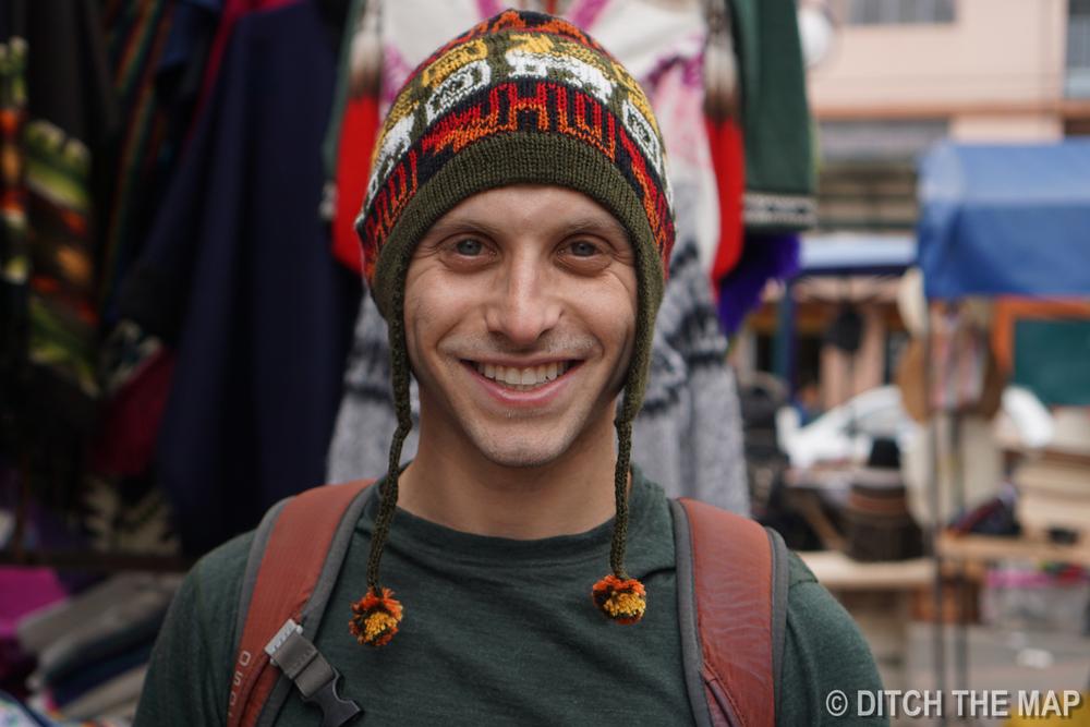 Scott buys an alpaca hat in Otavalo, Ecuador
