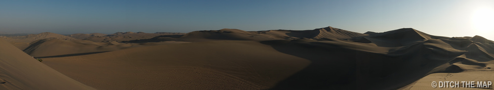 A panoramic view of the sand dunes in Huacachina, Peru