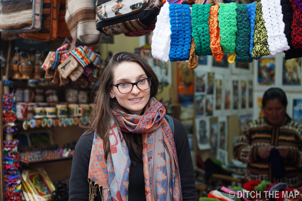Sylvie shows off her new scarf in a market in Cusco, Peru