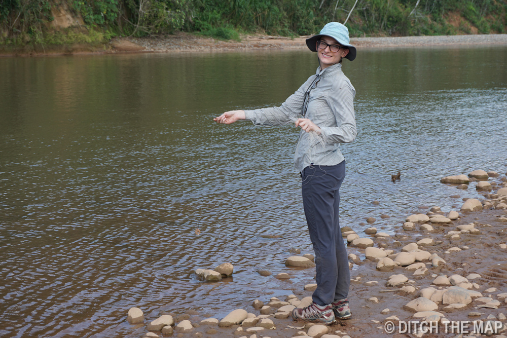 Sylvie fishes in the river during our trip to the Amazonian Jungle, Bolivia