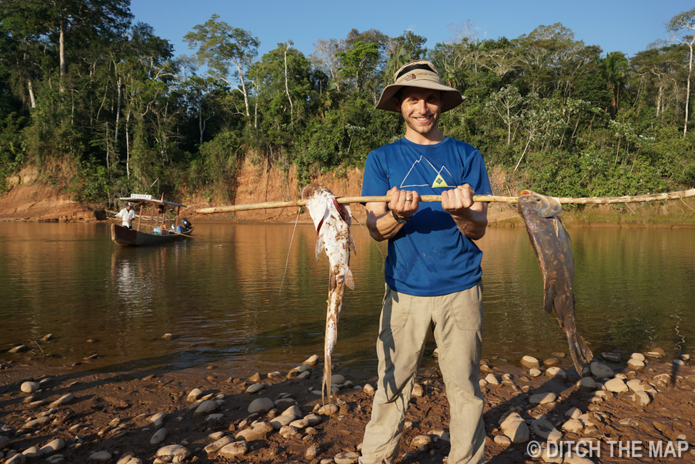 Scott holds our group's catch along the RIVER DURING OUR TRIP TO THE AMAZONIAN JUNGLE, BOLIVIA