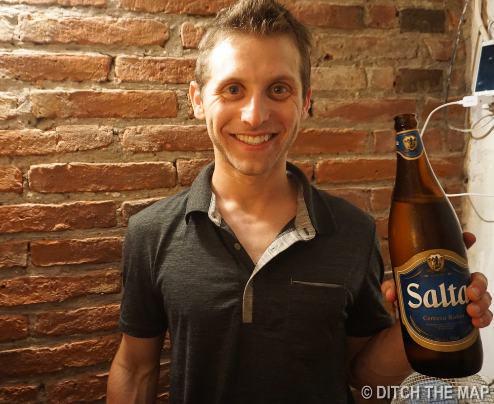 I enjoy a beer back at my hostel in Salta, Argentina