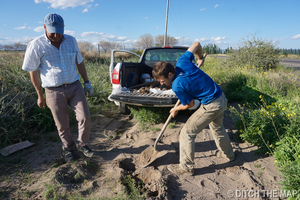 Orlando has me dig up organic soil in Tupungato, Argentina