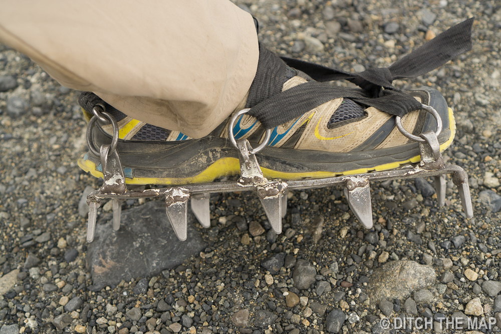 Putting on crampons to trek on Perito Moreno Glacier just outside El Calafate, Argentina
