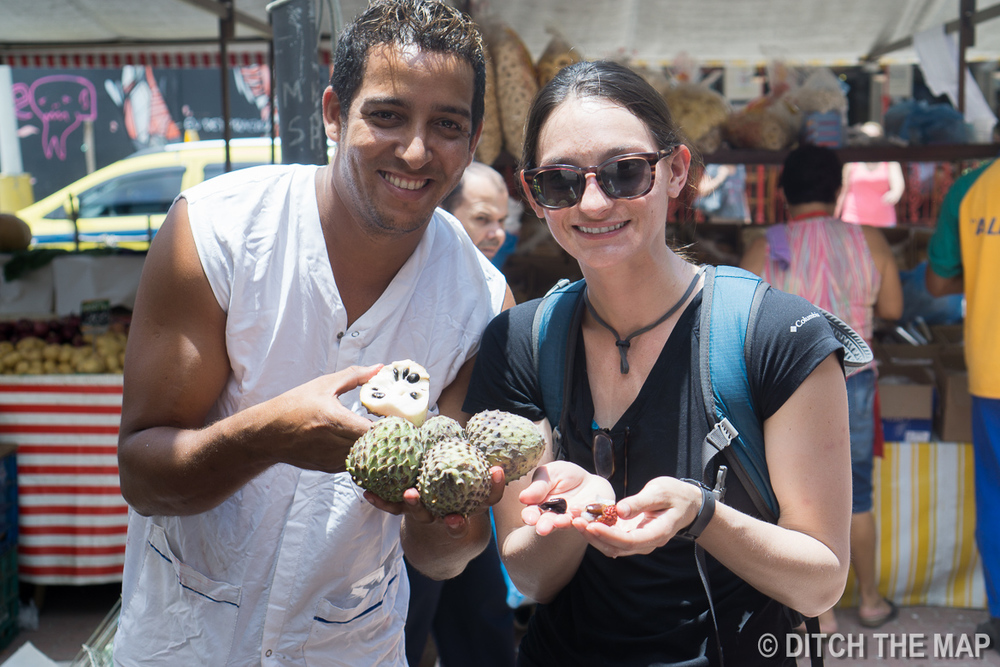 Trying fruit at the fruit market in Rio de Janeiro, Brazil