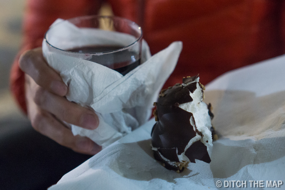 Enjoying hot wine and a chocolate covered marshmallow in Lisbon, Portugal