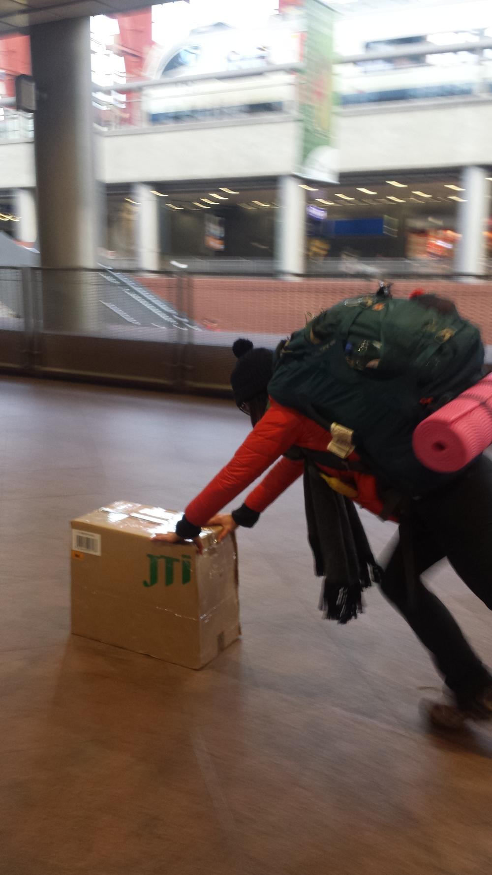 Sylvie helps in moving our large box of beer in Antwerp, Belgium