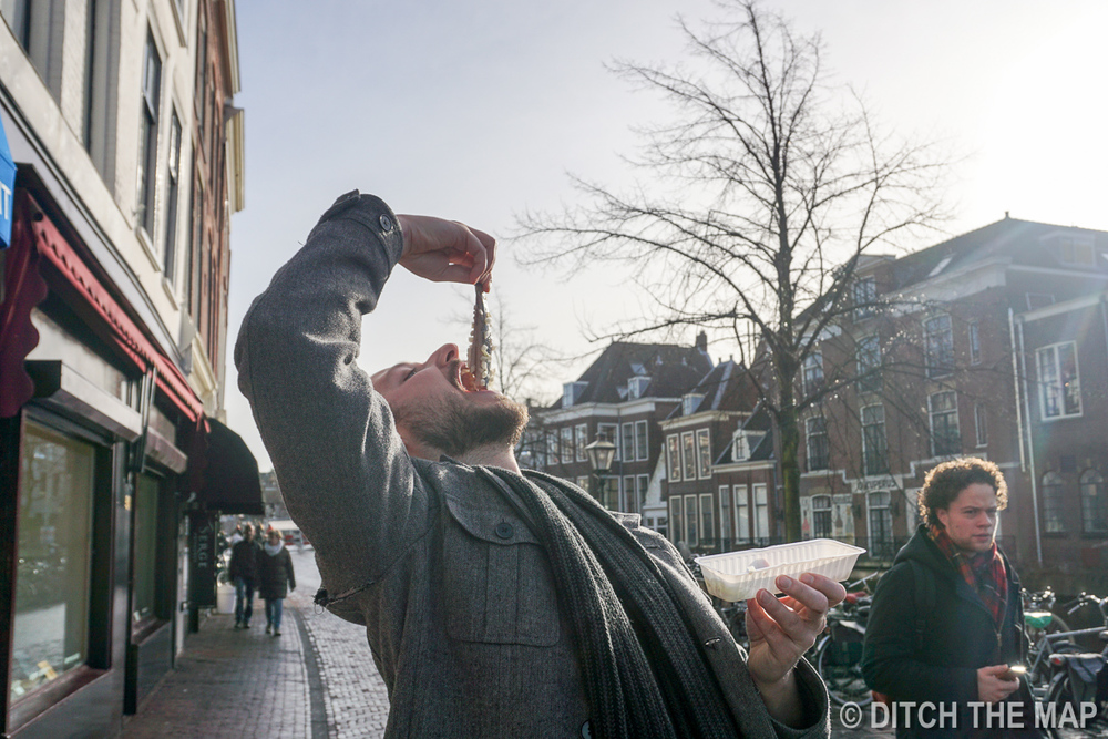 Dennis eats Herring in Leiden, Netherlands