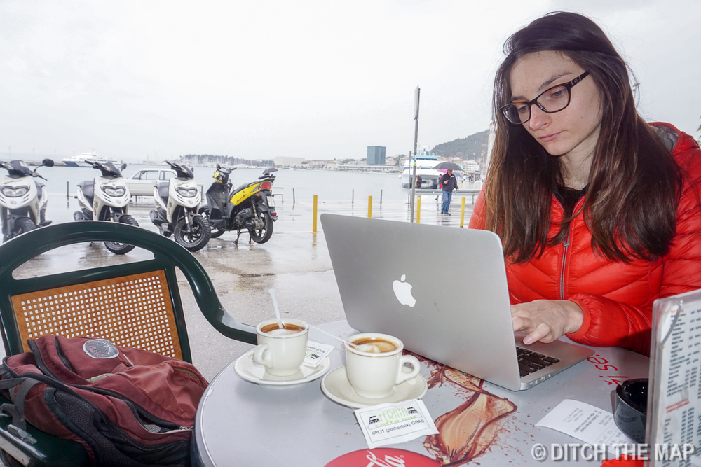 Grabbing coffee and writing our blog before our bus to Bosnia