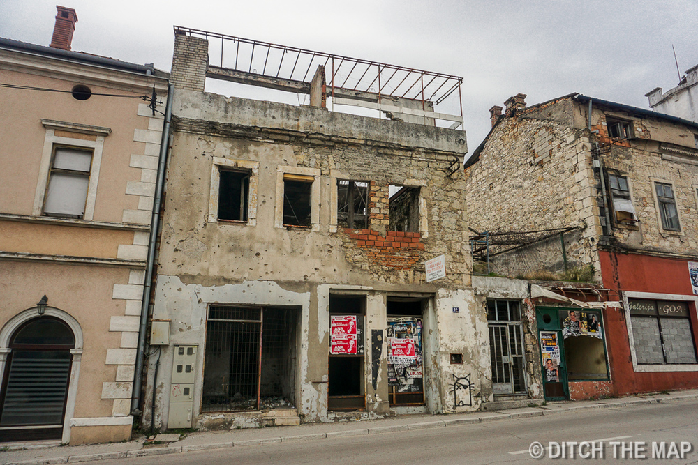New buildings next to Bomb Shattered buildings in Old Town Mostar, Bosnia