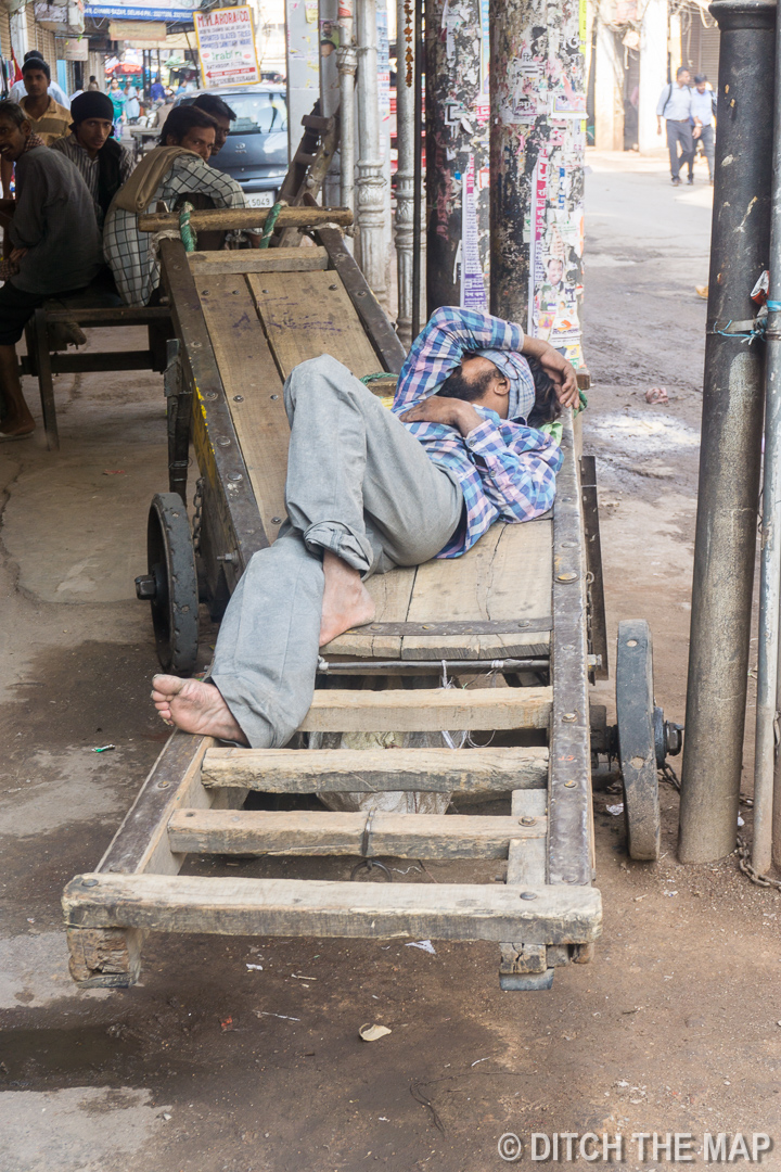 Sleeping before a day of work in Delhi, India