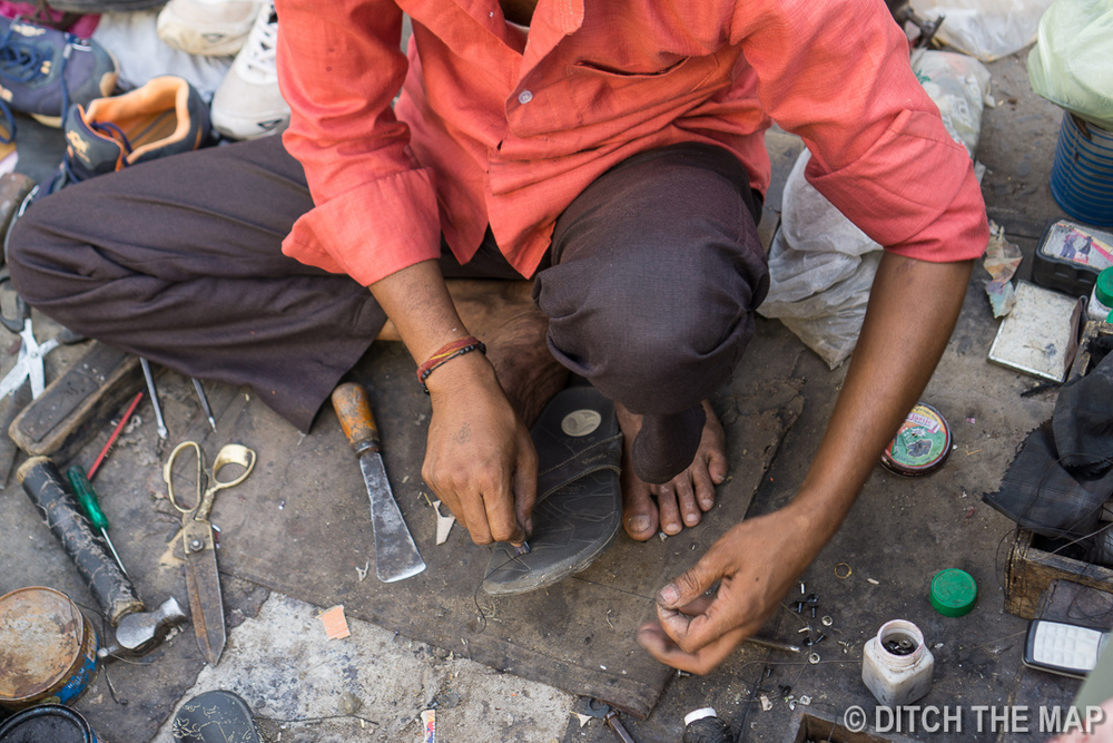 Getting my sandals repaired on the streets of Jodhpur, India