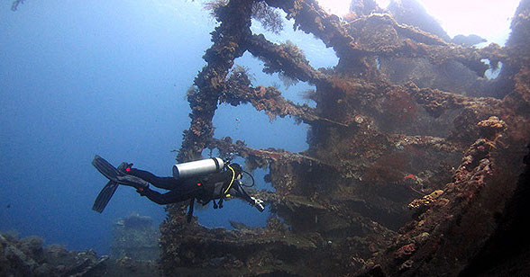 A SCUBA Diver in the Liberty Wreck outside Tulamben, Bali