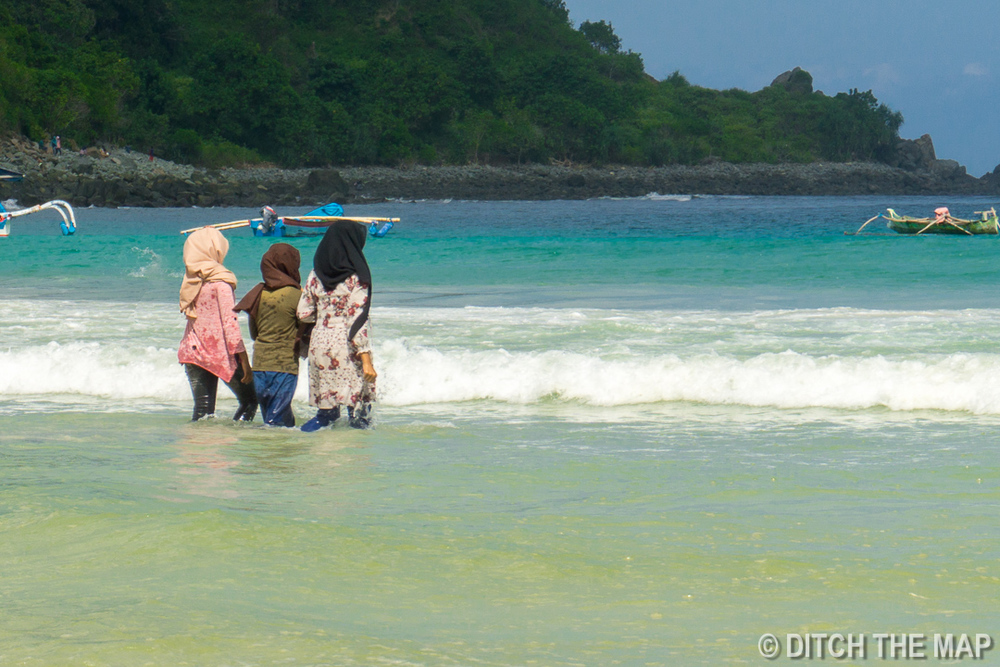 Local Women Swimming at Beach in Lombok, Indonesia