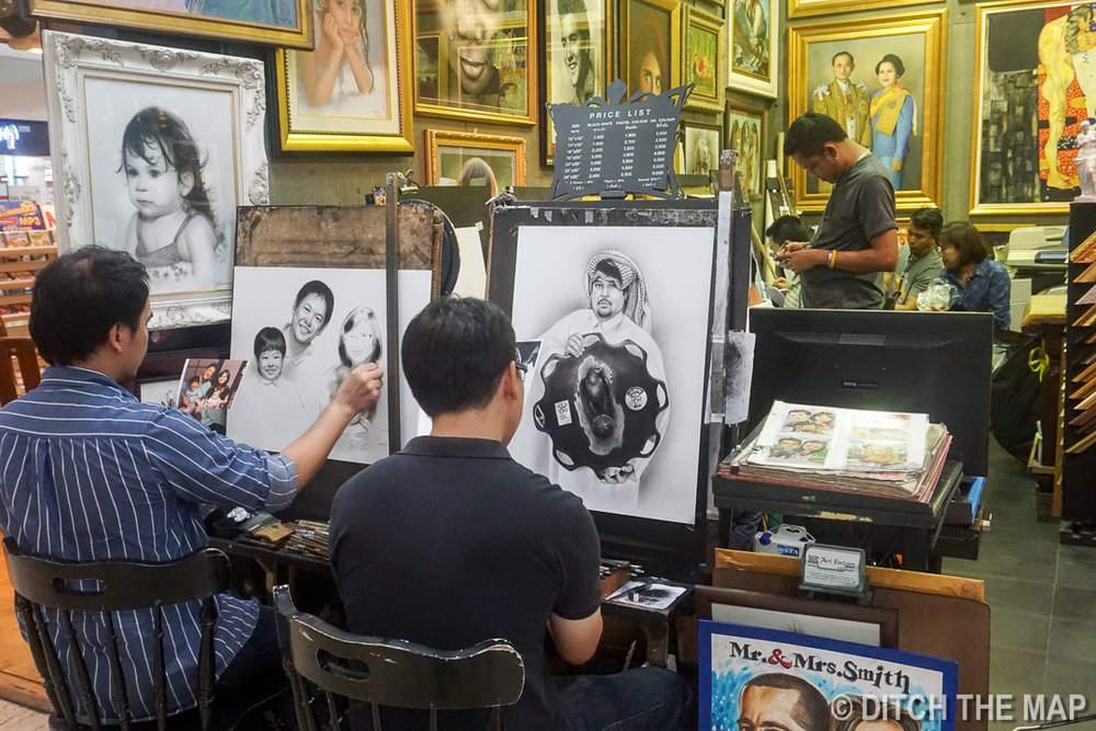 Men Drawing at MBK in Bangkok, Thailand