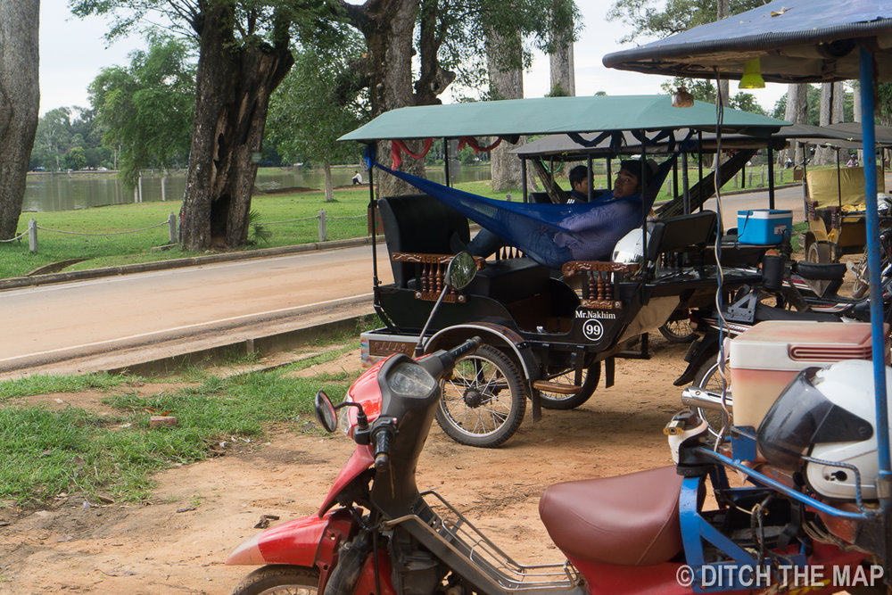 Tuk-Tuk Drivers Waiting for Their Customers Outside Angkor Wat, Cambodia