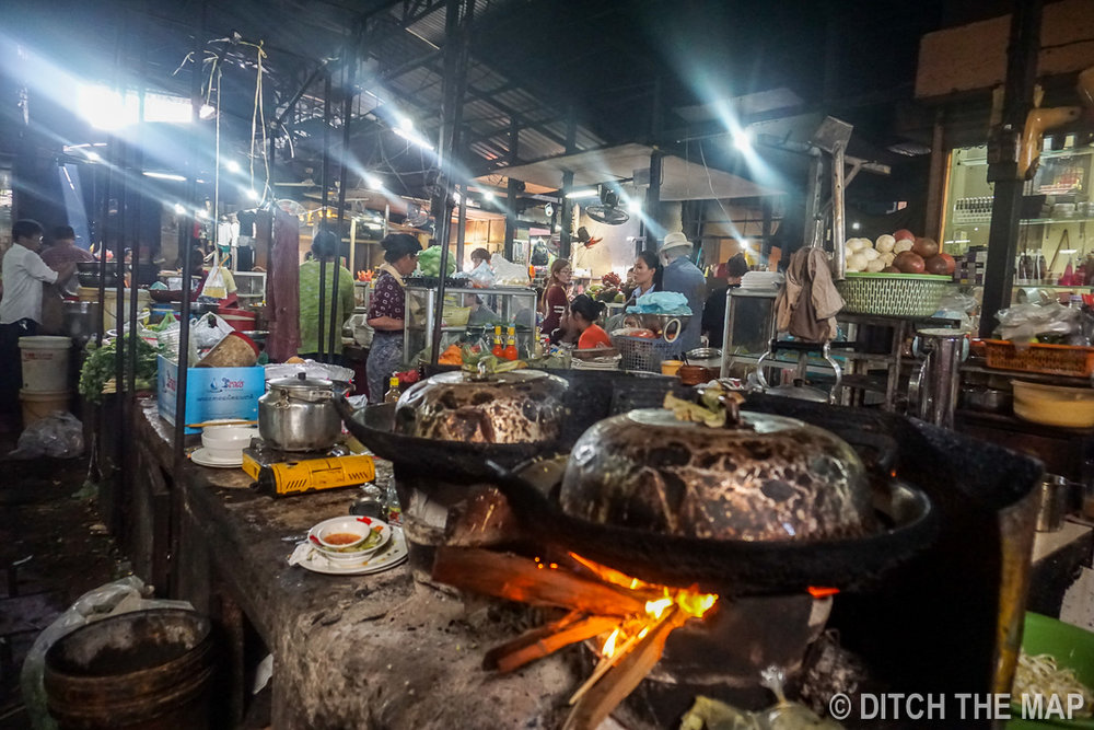 Enjoying a Local Meal at the Russian Market in Phnom Penh, Cambodia