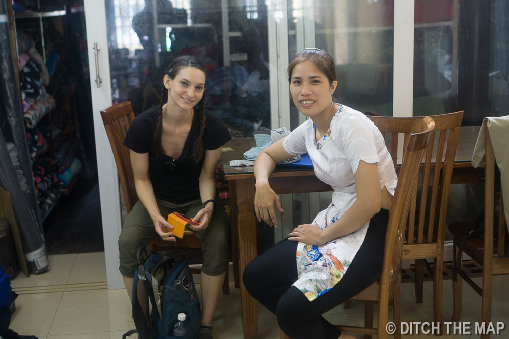 Sylvie and Su Wait While I Get 'Suited Up' at   Peace Tailor   in Hoi An, Vietnam