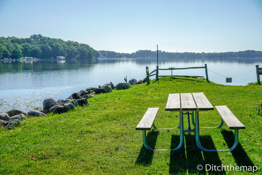 Picnic Table on Green Grass near Lake