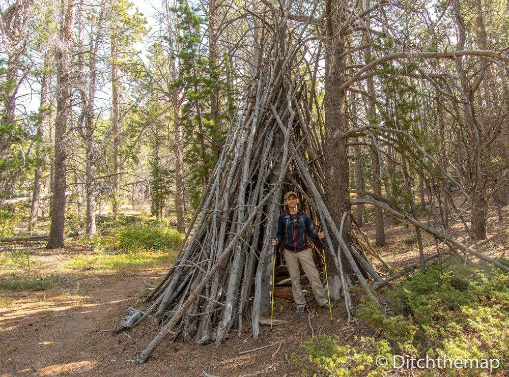 Scott seeking shelter from the sun near Vedauwoo, Wyoming