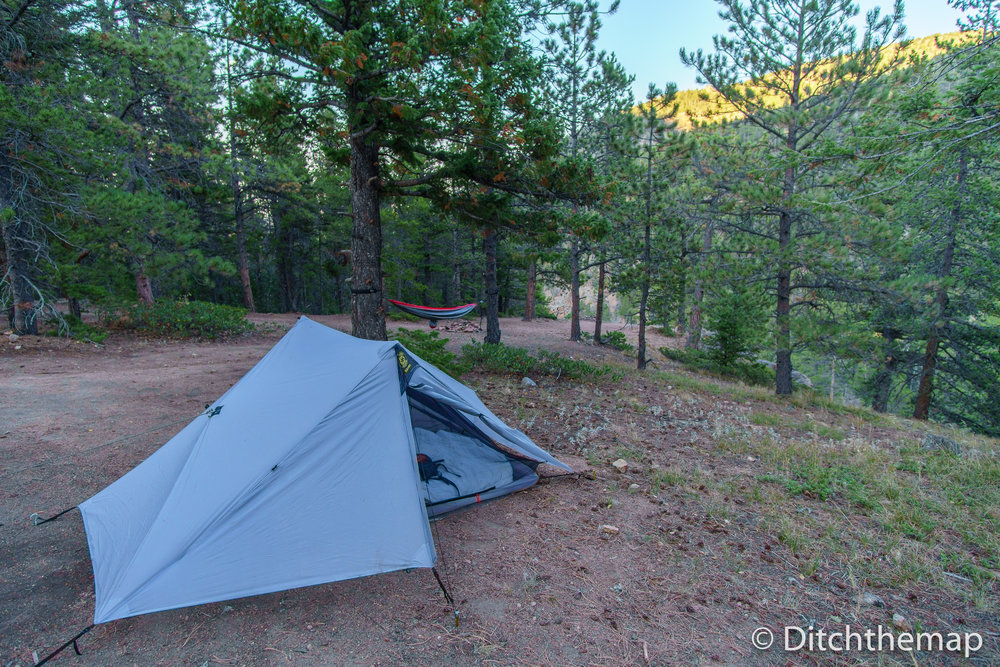 Campsite with tent and hammock in a National Forest