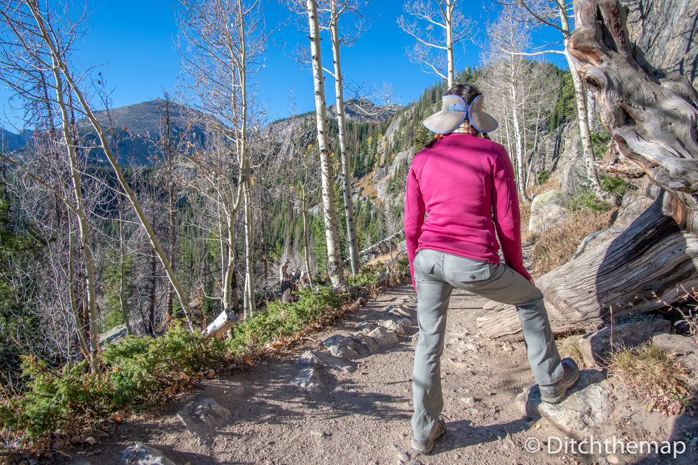 Girl Hiking and taking a look into the Rocky Mountains