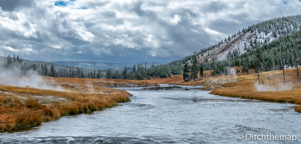 Yellowstone landscape with geisers all around