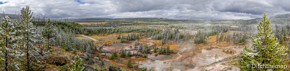 Panoramic view of Yellowstone landscape of geyser  pools and mud