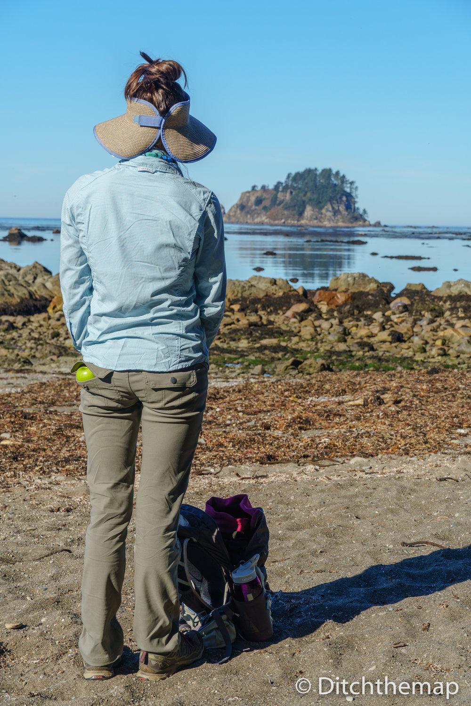 Along the rocky Washington coastline - Girl looking with apple i