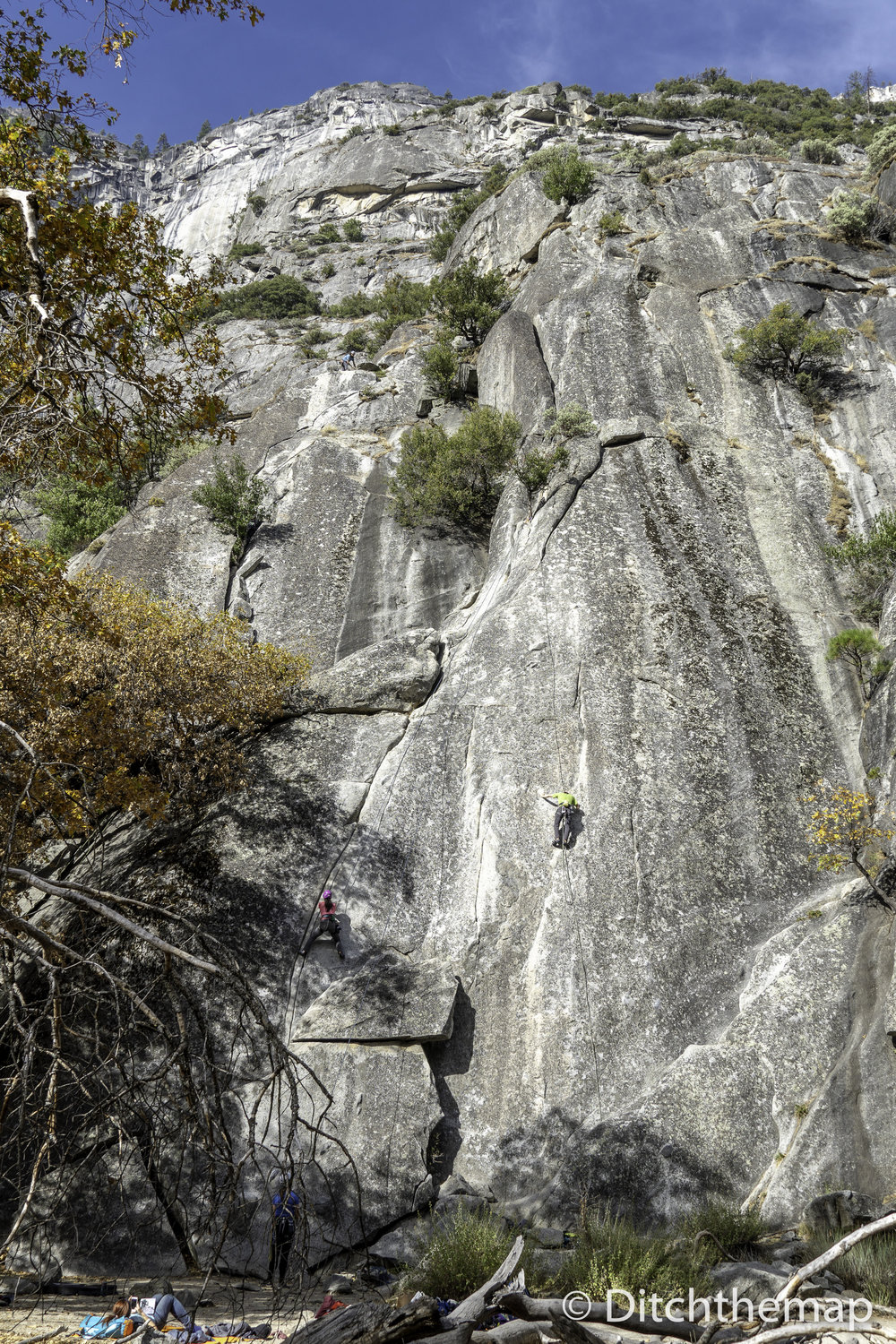 Adventurers climbing on large rocks in a national park