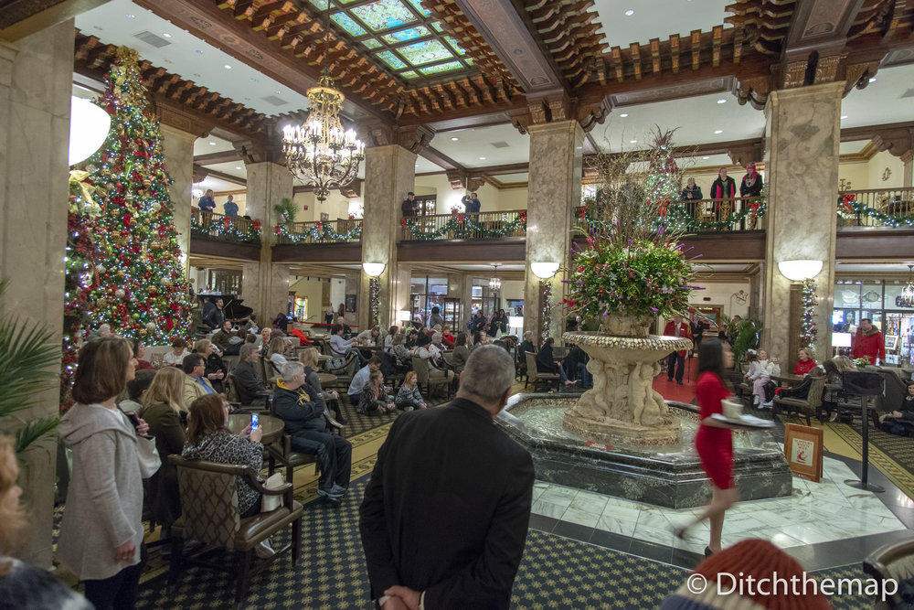 People swarm around the hotel atrium to watch the infamous Peabody Ducks at 11:00am in Memphis, TN