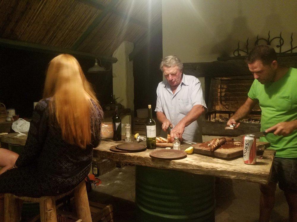the men prepare the asado meal