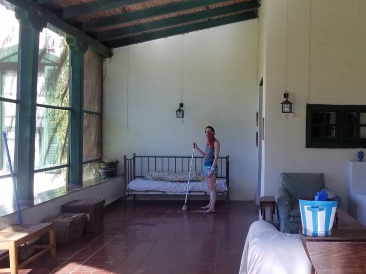 sylvie sweeping the veranda