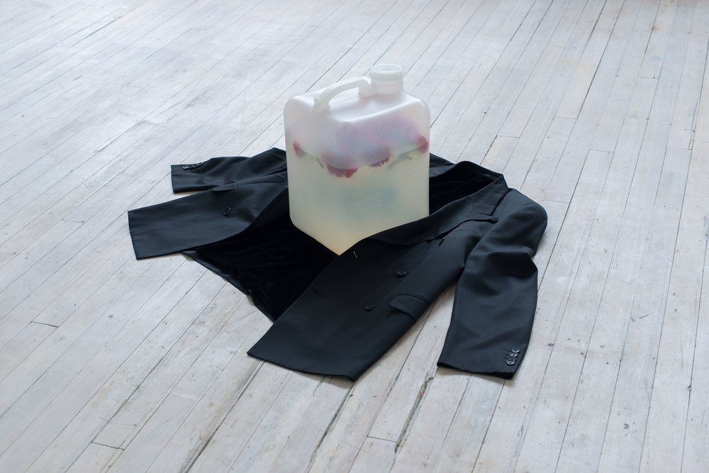Quay Quinn Wolf, My Man's Gone Now, 2018Velvet lined blazer, plastic jug, water, red carnations Dimensions variable