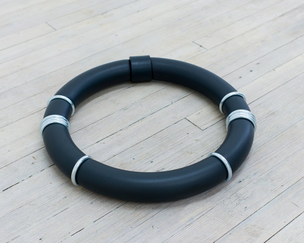 Michael Blake   Untitled (Ring #2),  2018 Solid foam tubing, plastic, steel, and nickel hardware, sock 21-inch Diameter