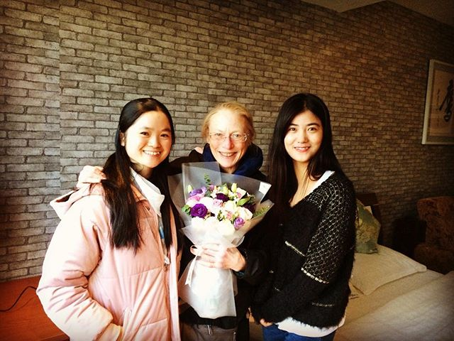 Arrival day in Beijing, China! My translator Zoe, social media host Judy (for filming online classes), and me with lovely gift of flowers. ❤️ #yogainbeijing #onlineyogainchina