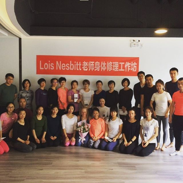 "Managed to squeeze in a public workshop on the last day of my trip in Beijing. Think the banner says ""Lois Nesbitt—we're so sorry!"" Just kidding, it says ""Lois Nesbitt yoga injury workshop"" or so they tell me.  #yogainchina #yogainbeijing #yogaworkshopchina #injuryclinicchina"