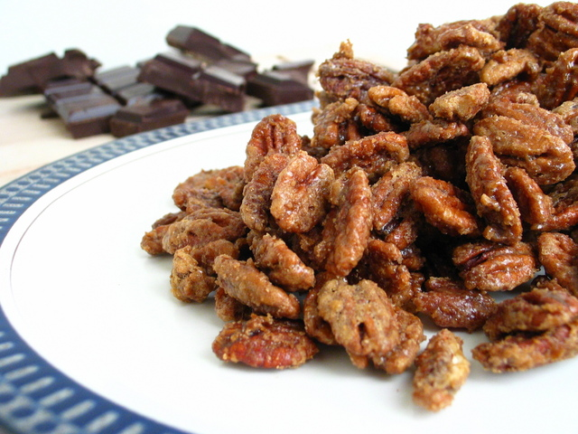 CANDIED PECANS INGREDIENTS 1/2 cup granulated sugar 1/2 cup brown sugar, packed 1 Tablespoon ground cinnamon 1 teaspoon salt 1/8 teaspoon cayenne 4 cups (12 ounces) pecans halves, unsalted 1 egg white, whisked INSTRUCTIONS Preheat oven to 300 degrees F. Add the granulated sugar, brown sugar, cinnamon, salt and cayenne to a large bowl or ziplock bag. Toss or whisk until evenly combined. Set aside. In a separate bowl, add pecans and egg whites, and gently toss until combined and the pecans are evenly coated. Add in the sugar mixture, and toss until combined. Spread the mixture out in a single layer on a parchment-lined baking sheet. (If your baking sheet is not that large, you may need to split the batch onto two baking sheets.) Bake for about 40 minutes, removing the nuts and giving them a stir every 20 minutes, until the pecans are fragrant and the sugar coating is cooked. (The sugar will harden more once the pecans are out of the oven.) Remove from the oven, and let the baking sheet cool on a cooling rack until the nuts reach room temperature. Transfer them to a sealed container and store until ready to use.  VIEW RECIPE SOURCE