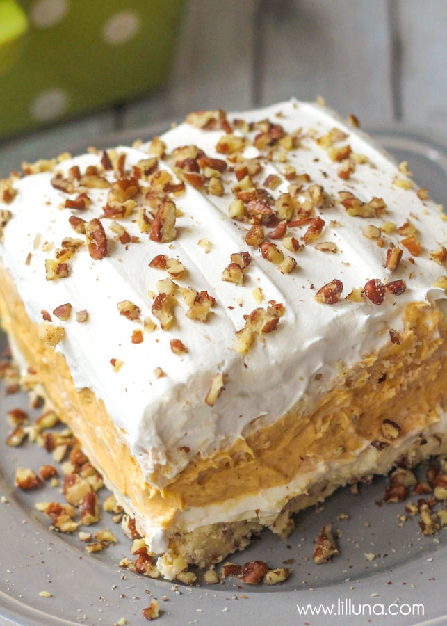 LAYERED PUMPKIN DESSERT  INGREDIENTS 1 cup Flour ½ cup Butter (softened) ½ cup plus ¼ cup Pecans, chopped 8 oz. Cream cheese, softened 1 cup Powdered sugar 3 cups Whipped topping, divided 2½ cups Milk 3 sm pkgs. White chocolate instant pudding mix (or vanilla) - 3.4 oz. boxes 1 - 15 oz can Pumpkin puree 1 tsp. Pumpkin spice  INSTRUCTIONS Layer 1: Mix flour, butter and ½ cup pecans together. Press into a sprayed 9x9 OR 9x13 pan. (If you would like more crust add an additional ½ cup flour, ¼ cup butter and ¼ cup chopped pecans) Bake for 15 minutes at 350 degrees, then remove and let cool. Layer 2: Blend cream cheese and powdered sugar, add 1 cup of the whipped topping then spread over cooled crust. Layer 3: Mix milk, pudding mix, canned pumpkin, pumpkin spice and 1 cup whipped topping until smooth. Spread over top of layer 2. Layer 4: Spread remaining 1 cup of whipped topping and sprinkle pecans. Let chill for 3 hours or until set.  VIEW RECIPE SOURCE  PHOTO CREDIT - LILLUNA.COM