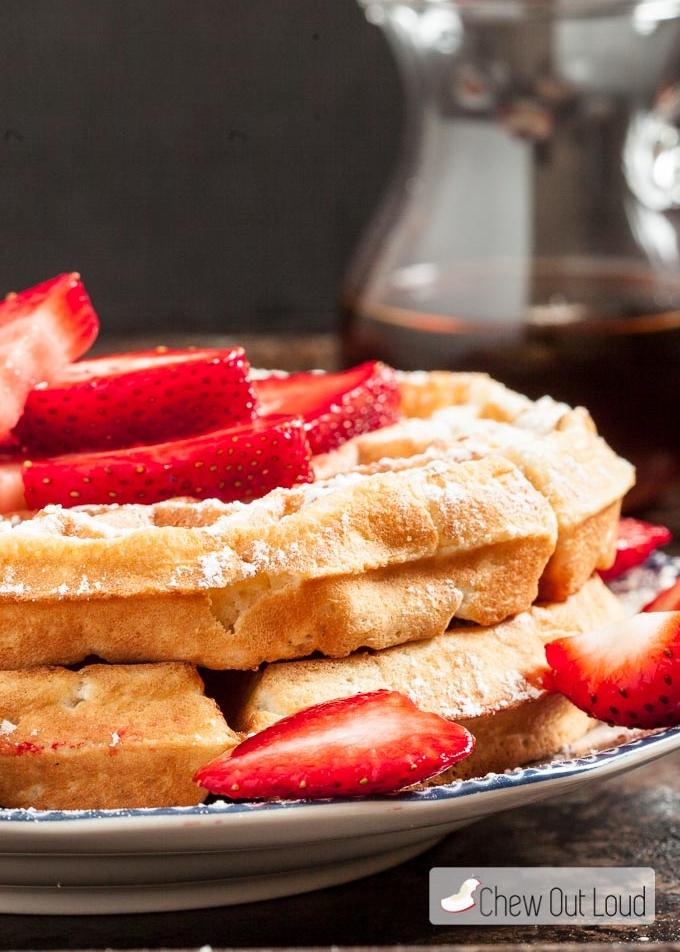 FLUFFY BELGIAN WAFFLES  INGREDIENTS 2 cups all purpose flour ¾ cups granulated sugar 3½ tsp baking powder 2 large eggs, whites and yolks separated 1½ cups whole milk 1 cup salted butter, melted 1 tsp pure vanilla extract For garnish: plenty of sliced fresh strawberries, powdered sugar, or maple syrup  INSTRUCTIONS In a bowl, whisk together the flour, sugar, and baking powder. In another bowl, lightly beat the egg yolks. Add the milk, butter, and vanilla to the yolks. Mix well until combined. Stir yolk mixture into the flour mixture with a rubber spatula, just until combined. Using an electric mixer and a separate clean bowl, beat the egg whites until stiff peaks form. Use rubber spatula to gently fold the stiff egg whites into waffle batter, just until combined. Do not over mix. Let batter rest 10 minutes while you preheat the waffle iron. Cook waffles in heated waffle iron according to manufacturer's instructions, until waffles are golden. Serve with fresh strawberries, powdered sugar, or maple syrup.  VIEW RECIPE  PHOTO CREDIT - CHEWOUTLOUT.COM