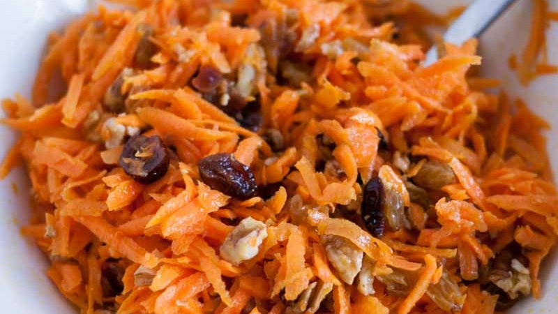 QUICK CARROT SALAD WITH RAISINS, CRANBERRIES, AND NUTS           VIEW RECIPE           PHOTO CREDIT - VEENAAZMANOV.COM