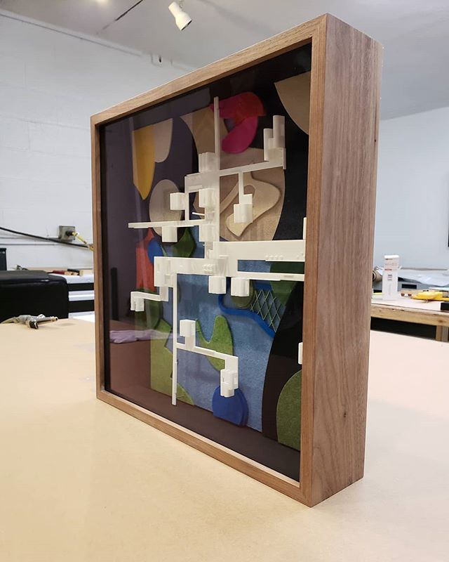 A framed architectural model by Standard Architecture. @standardarchitecture #shadowbox #walnut #picture framing #architecture #addidas