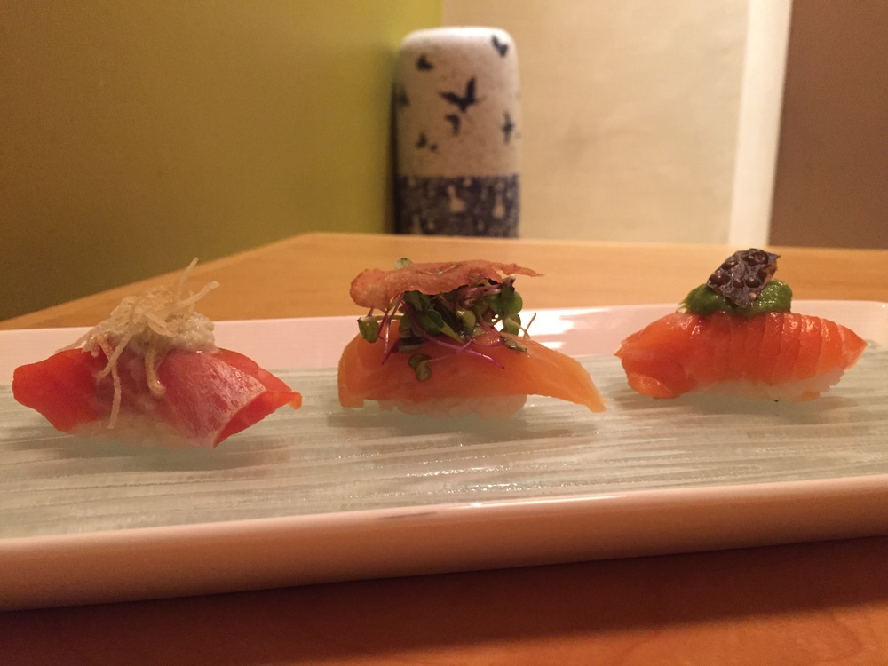 Sockeye Salmon with Wasabi Pistachio Puree and a potato crisp Arctic Char with a micro-green salad tossed in a white grapefruit balsamic vinegar lotus root chip New Zealand King Salmon with a scallion sauce and a Konbu crisp
